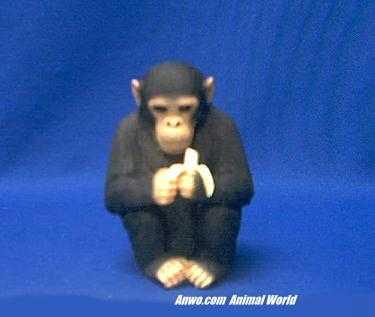 chimpanzee figurine statue holding a banana