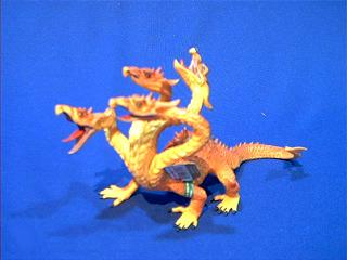 gold dragon toy 4 headed