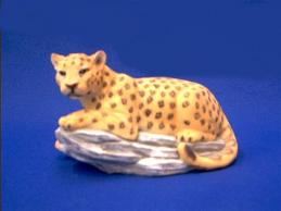 leopard figurine on rock