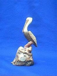 brown pelican figurine John Perry
