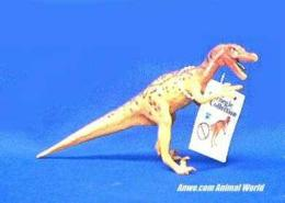 velociraptor toy dinosaur miniature orange